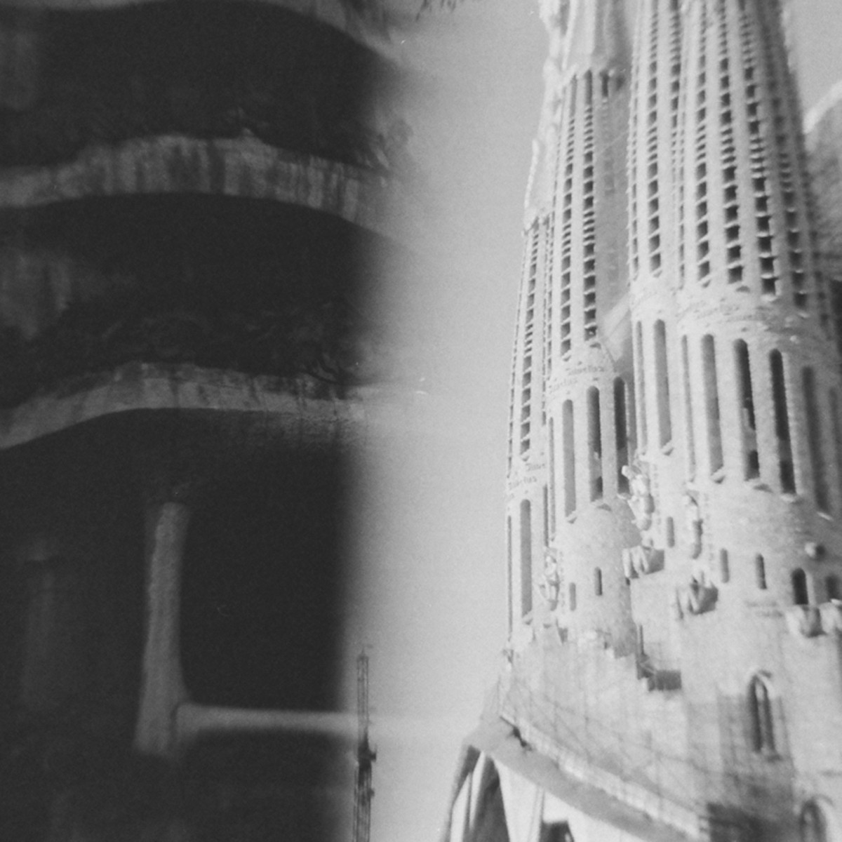 A split-exposure of the Sagrada Familia and another one of Gaudi's buildings.