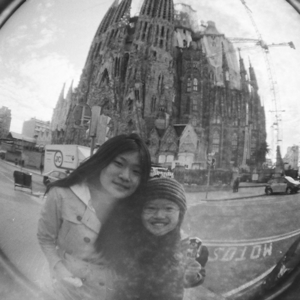 In front of the whimsical and ridiculously grand and out-of-proportions Sagrada Familia. Gaudi is amazing.